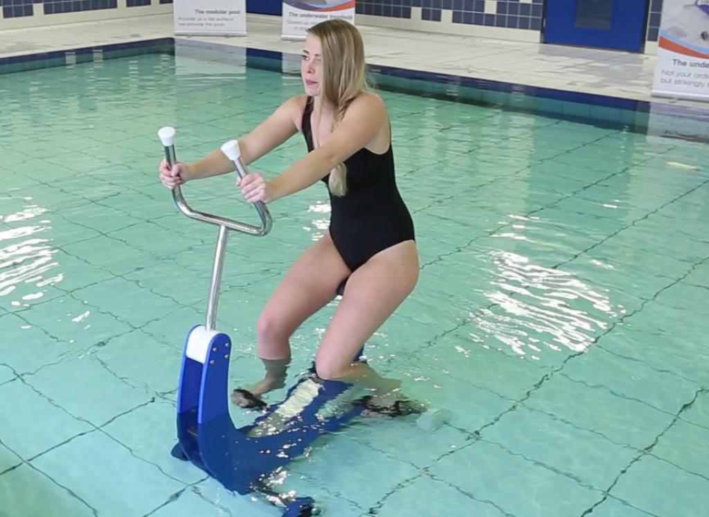 Underwater bicycle in knee deep water with model