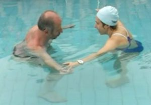 Therapist and patient in Aquatic Therapy session